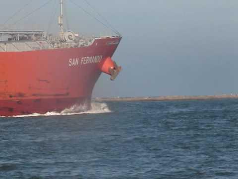 Dolphins Chasing tanker ,Port Aransas , Jetties
