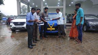 Taking delivery of Hyundai Santro