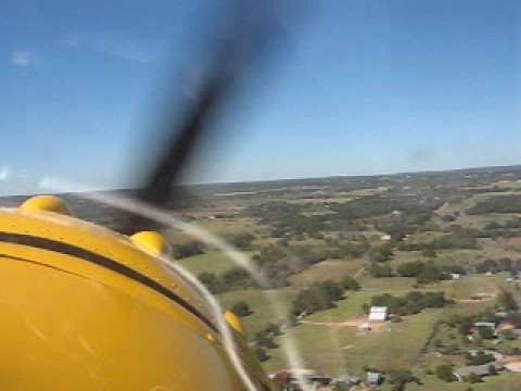 Take-off from Fredericksburg, Texas, Gillespie County Airport, T82 on runway 32 in a classic 1950 C-195 passing the Hangar Hotel.