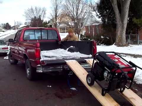 ONE Man EZ Load loads a large emergency / backup power generator onto a pickup truck