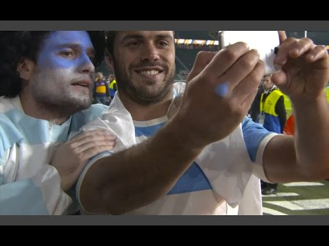 Slow Mo Emotion:  Argentine players & fans pitch-side post-match