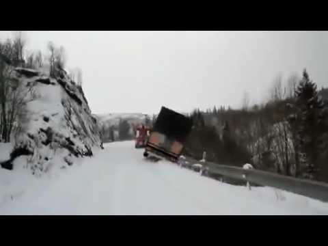Lorry and tow truck slide off snowy cliff in Norway