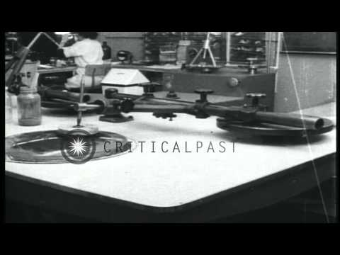 Precision grinding of glass lenses at Northrop Aircraft Company, Anaheim Division...HD Stock Footage