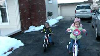 3 1 2011 Kids riding there new bikes outside for the 1st time