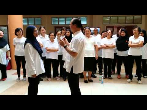 Demonstrating one's energy fields at my U3A UPM Qigong class with dowsing rods in Serdang, Malaysia