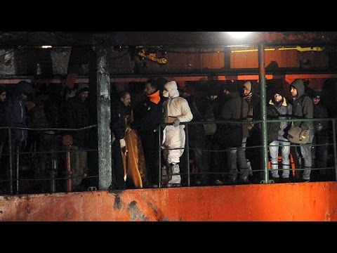 Italy coast guard boards new abandoned migrant ship