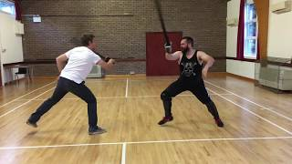 Sabre sparring with foam sabres and no protective gear.