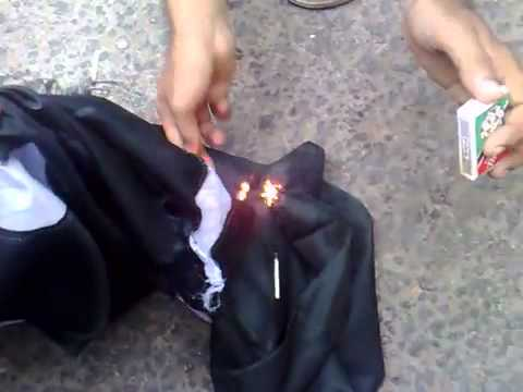 Beloch people burning Paki flag.flv