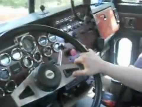 Loud Jake brake and down shifting cat engine Peterbilt logging truck.