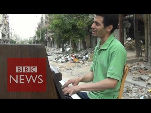 Pianist of Yarmouk films his journey from Syria to Europe - BBC News