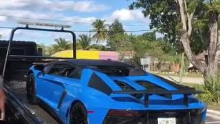 Lamborghini Aventador SV Roadster Getting Lifted On A Truck | Supercars