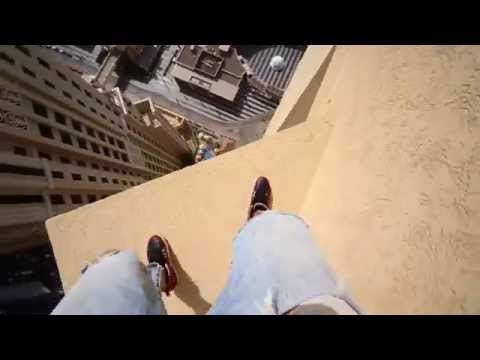 Man Leaps From Skyscraper Ledges In Unbelievable Parkour Stunt