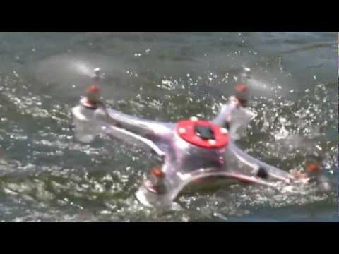 Waterproof Quadcopter swimming and splashing in pond