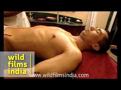 Four hand body massage at a spa resort in India. Traditional south Indian Ayurvedic Kairali full body and head massage, zits and all! This is a luxury destin...