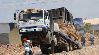 Loading Bulldozer on Trailer and Excavator Working