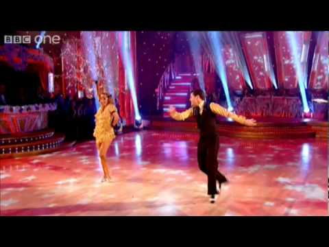 "http://www.bbc.co.uk/strictly Chris Hollins and his dance partner Ola Fortuna perform a Charleston to ""Fat Sam's Grand Slam"" by Paul Williams."