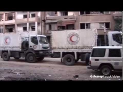 Syria: Mortar fire halts Homs aid efforts