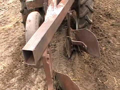 самодельный трактор.регулировка плуга.