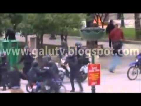 Petrol Bomb on policeman's head - Riots in Athens /  Greece - 23 / 2 / 2011