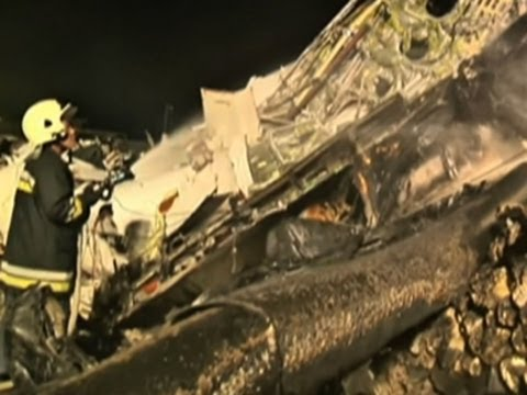 Raw: Rescue Workers at Taiwan Plane Crash Site