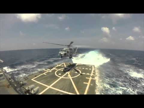 U.S. Navy Sea Hawk helicopter searches for missing flight MH370
