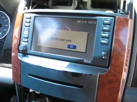 How to Remove Radio / Navigation / CD Changer from Cadillac SRX  2005 for Repair.