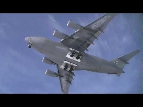 This is an United States Air Force C-17 Globemaster flying directly over and landing at Gander International Airport, in the background you can see an Antono...