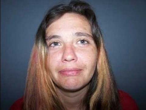 Police: Drunk, nude woman tries to bite officer