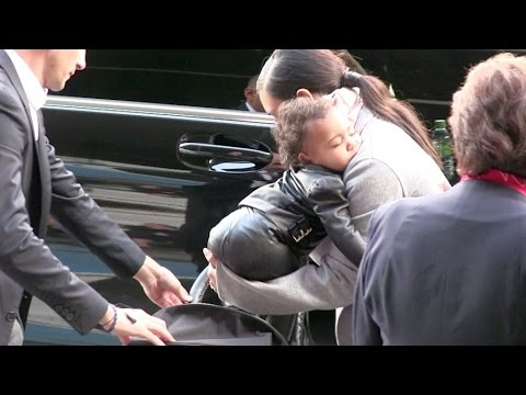 Kim Kardashian and her adorable daughter North leaving Paris