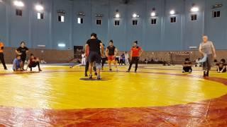 Kripa Shankar Patel Bishnoi demonstrating techniques to Sakshi Malik and Indian female wrestling