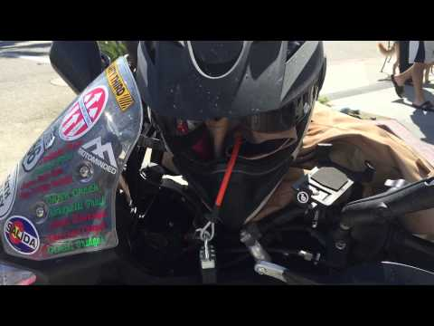 Securing helmet and riding jacket to motorcycle with Giant Loop's 36