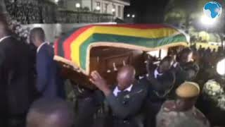 "Coffin of ex-president Mugabe arrives at the ""Blue Roof"""