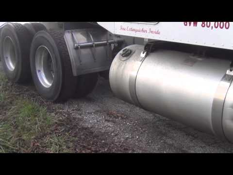 Tow Truck Winching A Loaded Tractor Trailer