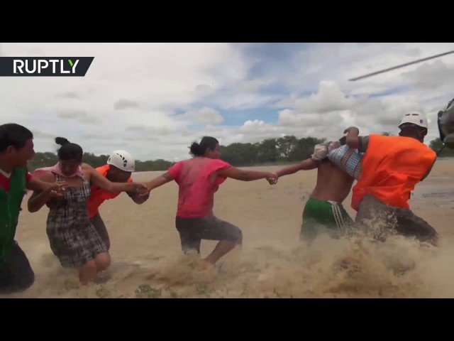 RAW: Peruvians trapped in powerful flood, evacuated by helicopters