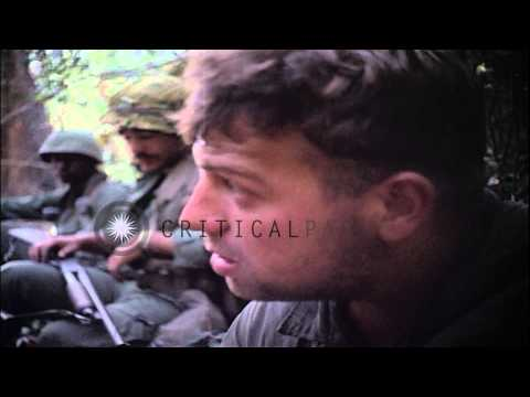 Medic gives first aid to wounded US soldiers. HD Stock Footage