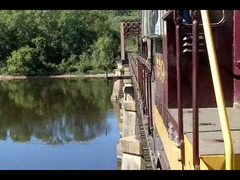 Train crossing river bridge from Wisconsin to Minnesota, Osceola & St. Croix Valley Railway