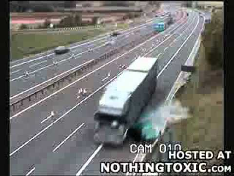 Semi takes out small car - Brought to you by MojoFlix.com.flv