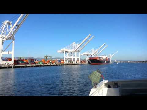 Ferry Ride View. Container Ship APL Singapore & Shipping Container Cranes, Port of Oakland.