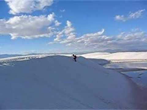 rolling down the white sand dune
