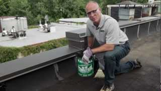 How to repair flat roof leaks inexpensively with 18 Flashing Cement - KARNAK