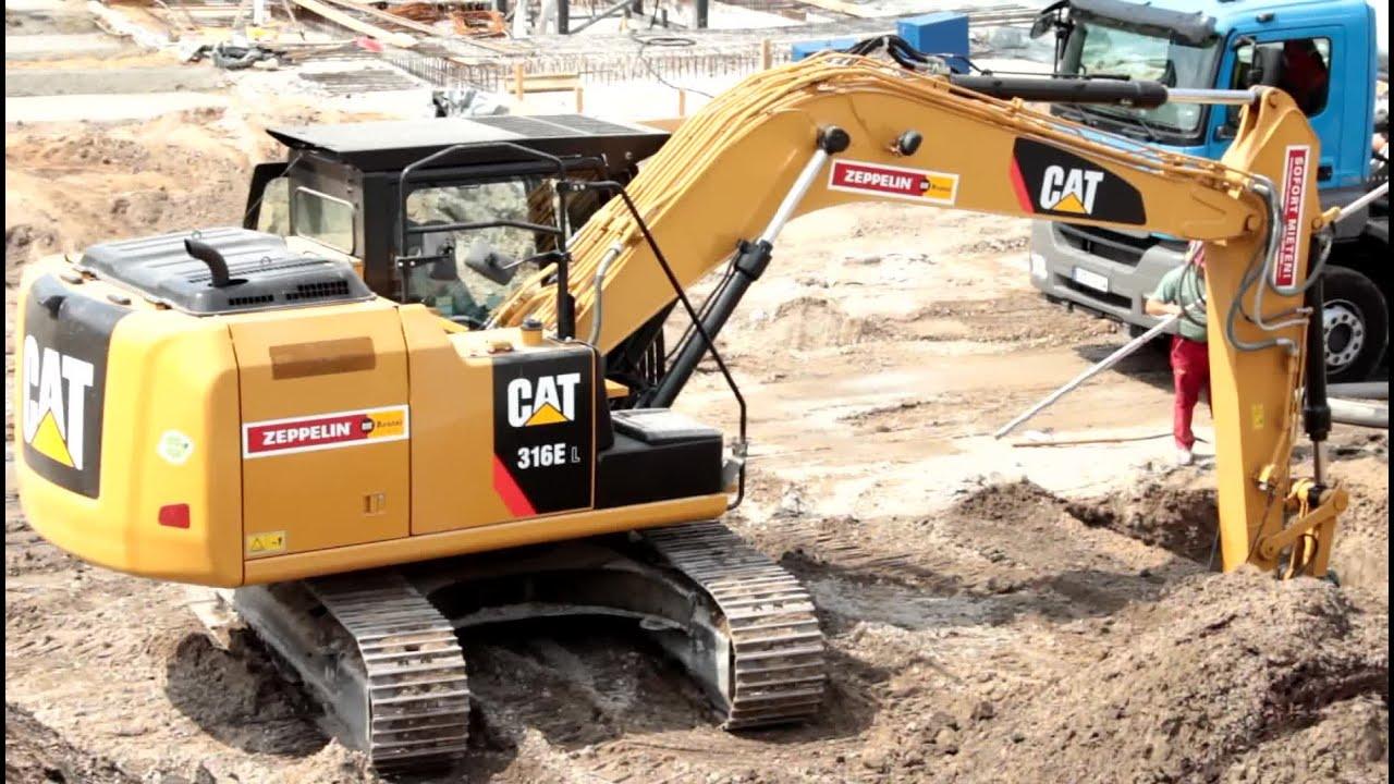 Cat Excavator Digging Holes Construction Site