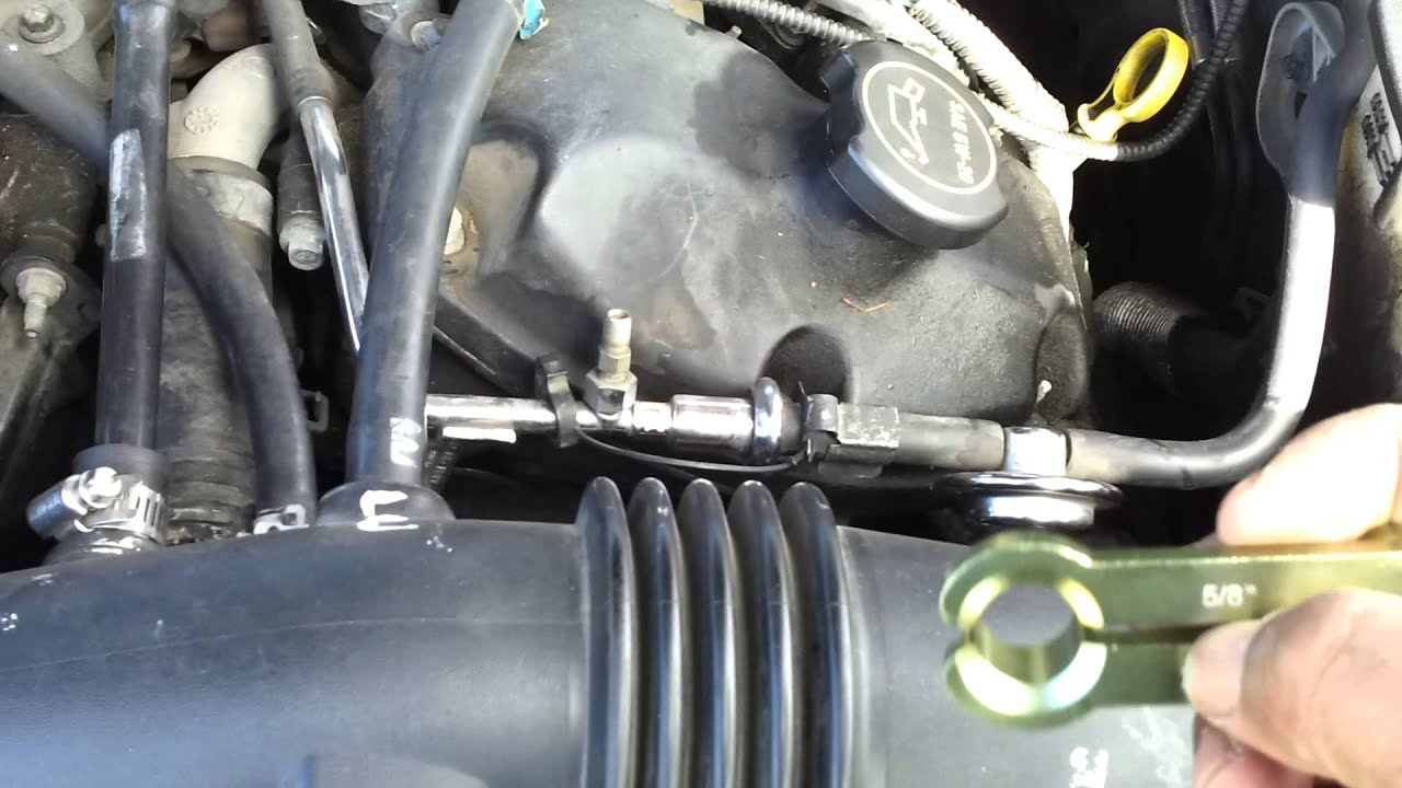 Disconnecting Fuel Line And Disconnect Tool On 2001