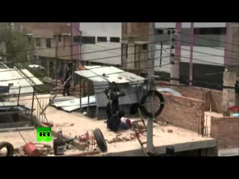 GRAPHIC: Police open fire at residents resisting eviction in Peru
