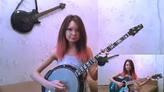 "Janna plays ""Drunken Sailor"" on banjo and guitar."