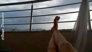 Feet lounge on my loggia before the storm