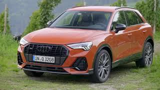 2019 Audi Q3 in Pulse Orange Driving Scene
