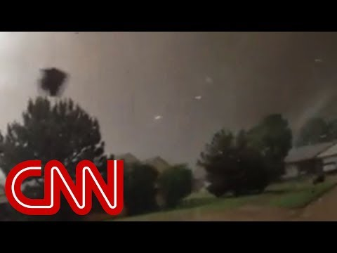 Dad drives through storm to get son as tornado hits