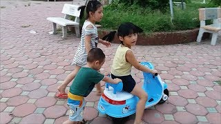 Gia Linh and Gia Bảo practice driving motorcycles in the playground for children