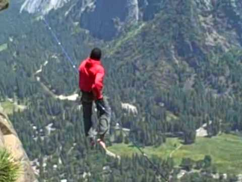 Crazy German guy walking tightrope over Yosemite falls