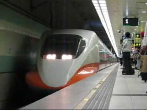 "Taiwan High Speed Rail Southbound Rapid 409 approaches and departs at HSR Taoyung Station . Edited by Windows Movie Maker . Canon S2 IS , 320x240 15"" . Gordo..."